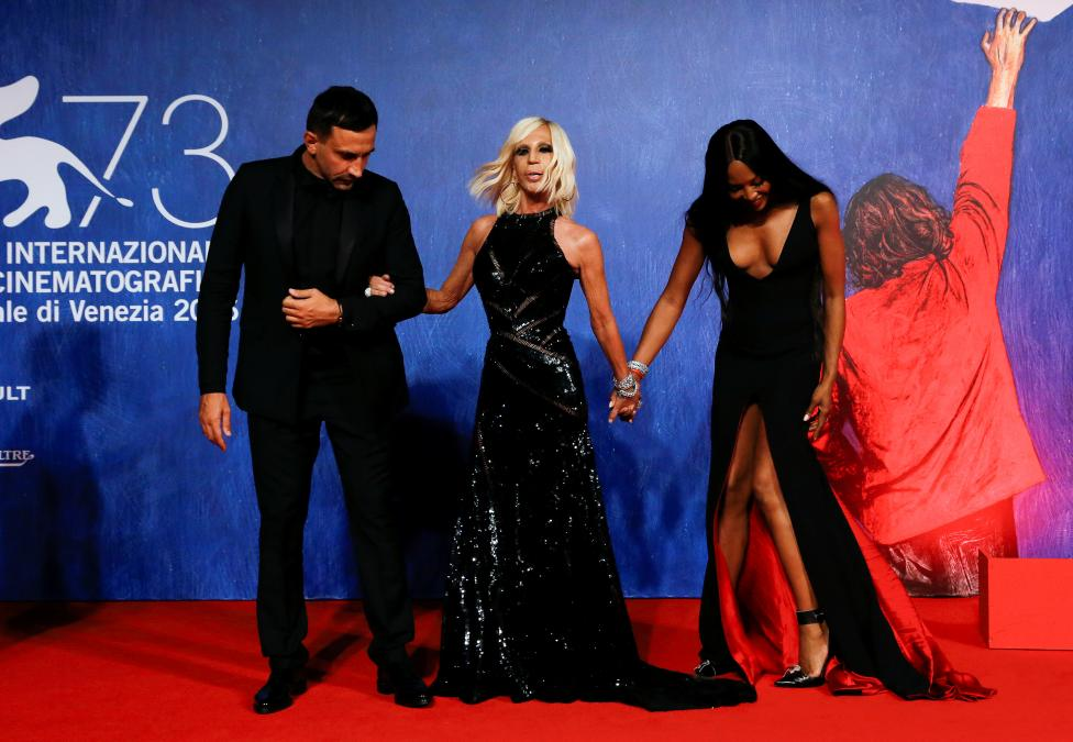"""Designers Riccardo Tisci, Donatella Versace and model Naomi Campbell attend the red carpet for the movie """"Franca: Chaos and Creation"""" at the 73rd Venice Film Festival in Venice"""