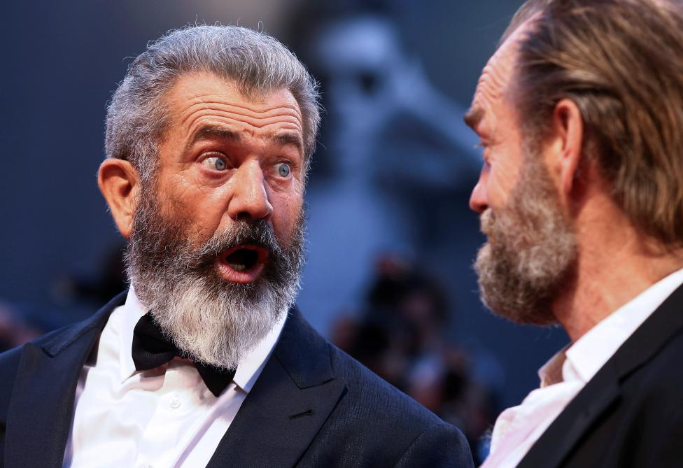 """Director Mel Gibson and actor Hugo Weaving attends the red carpet for the movie """"Hacksaw Ridge"""" at the 73rd Venice Film Festival in Venice"""