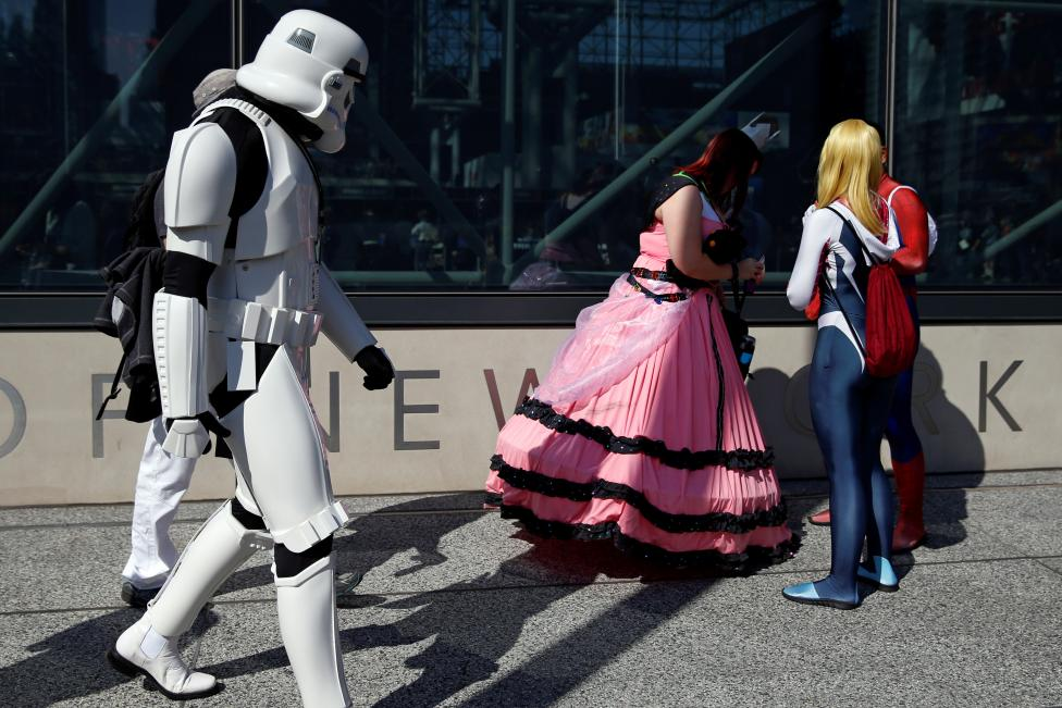 People dressed in costume are seen outside the New York Comic Con in New York