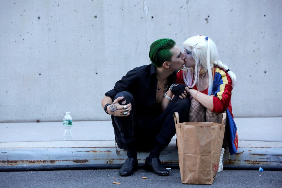 A couple dressed as The Joker and Harley Quinn kiss at New York Comic Con in Manhattan