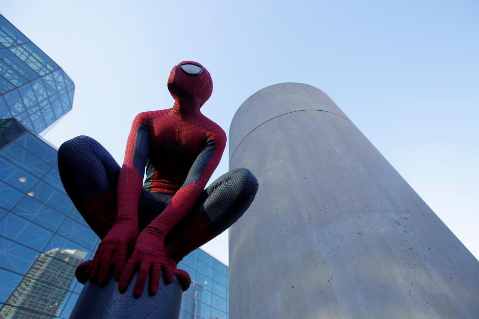 A man in a Spiderman costume poses at New York Comic Con in Manhattan