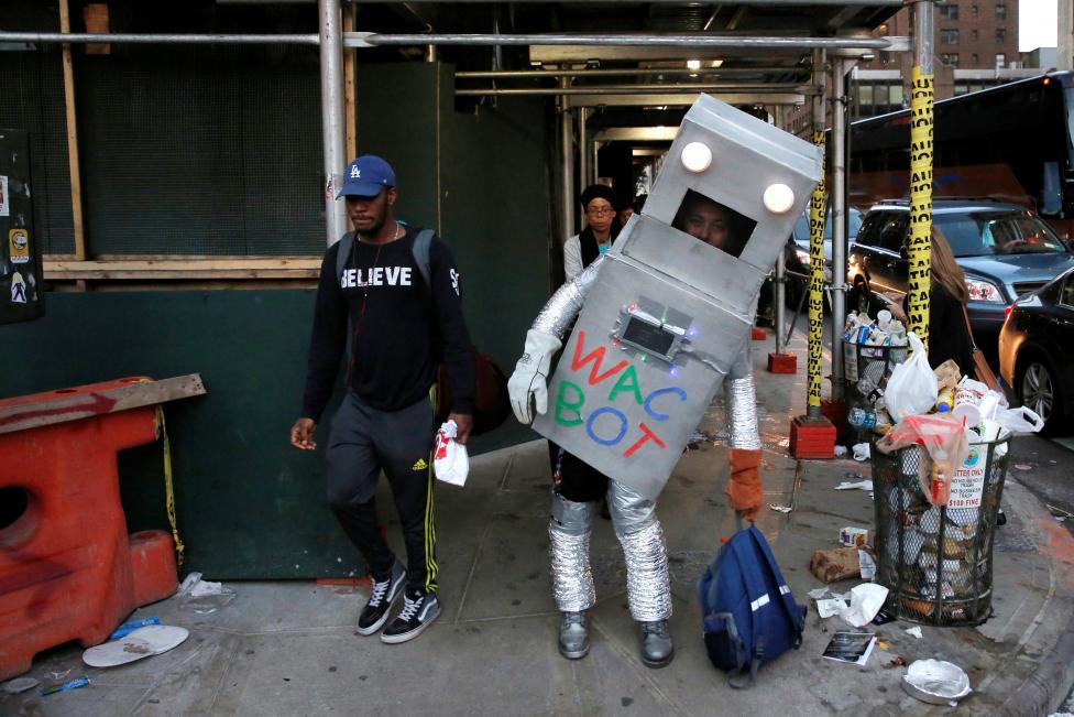 A man dressed as Wac Bot walks under scaffolding toward New York Comic Con in Manhattan