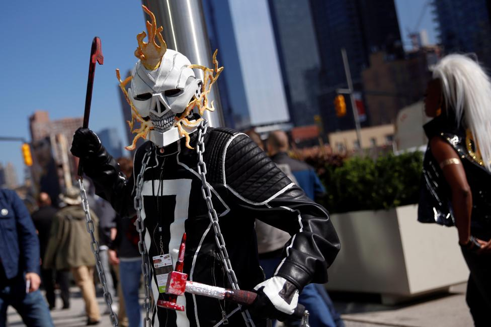 A man dressed in costume poses outside the New York Comic Con in New York