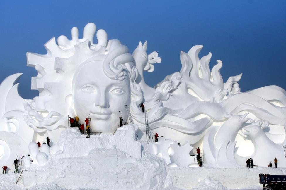 Artists work on snow sculptures at the Harbin International Ice and Snow Sculpture Festival in Harbin, Heilongjiang province, China. REUTERS/Stringer