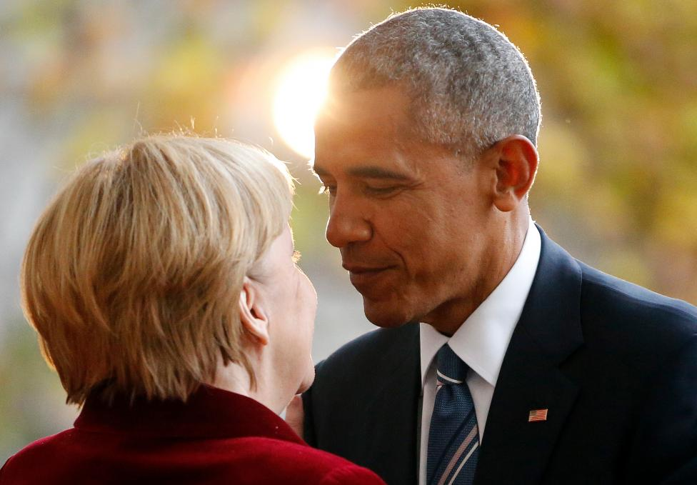 U.S. President Obama is welcomed by German Chancellor Merkel upon his arrival at the chancellery in Berlin