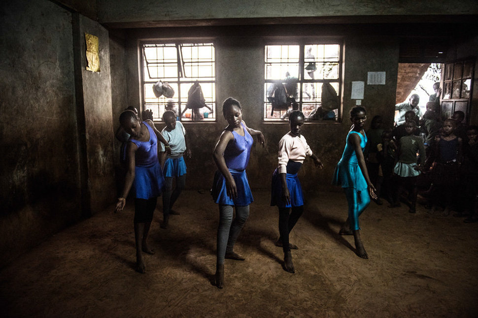 Some of the older girls is practicing a dance they do together. There is always curious onlookers when the students practice