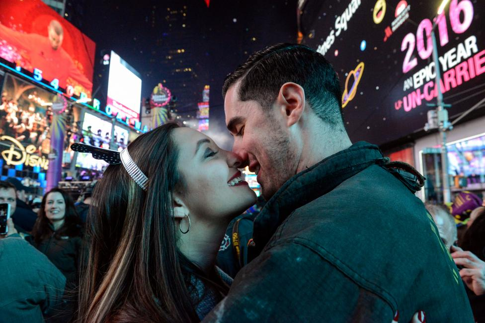 Jillianne Sabatini and Stephen Regalia share a kissmark the new year in Times Square in New York