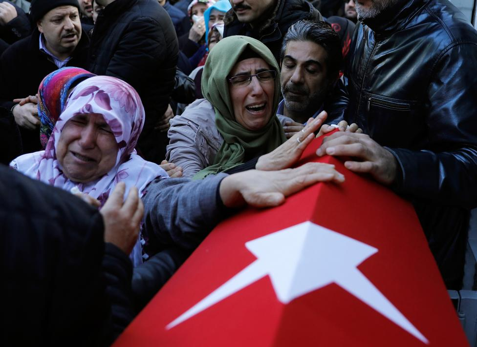 Mother of Cakmak, a security guard and a victim of an attack by a gunman at Reina nightclub, reacts during his funeral in Istanbul