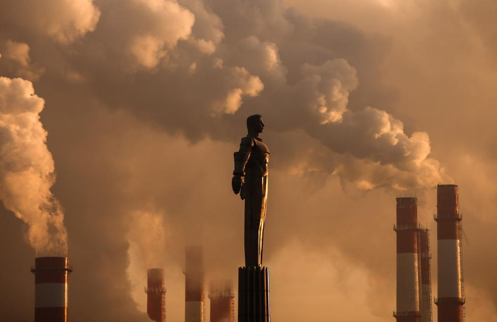 Steam rises from chimneys of a heating power plant near a monument of Soviet cosmonaut Yuri Gagarin in Moscow