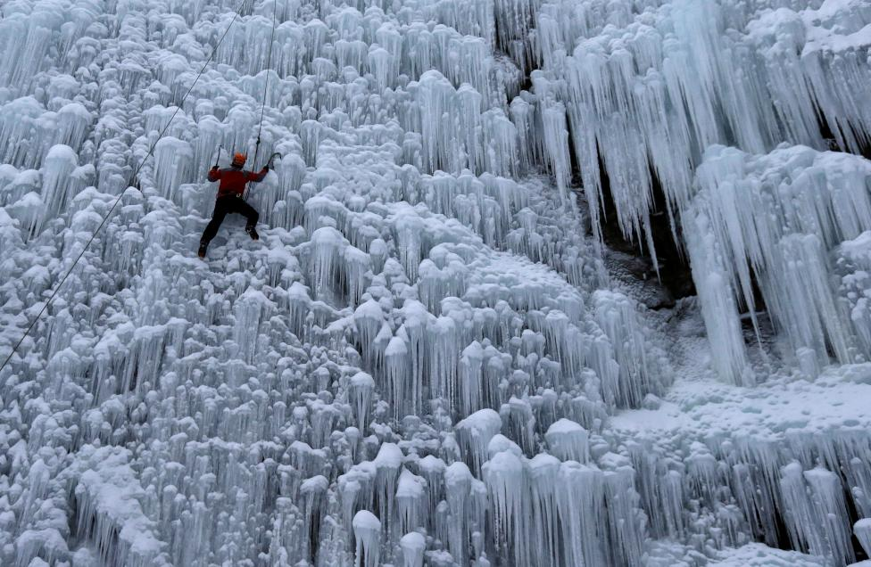 A man climbs an artificial wall of ice in the city of Liberec
