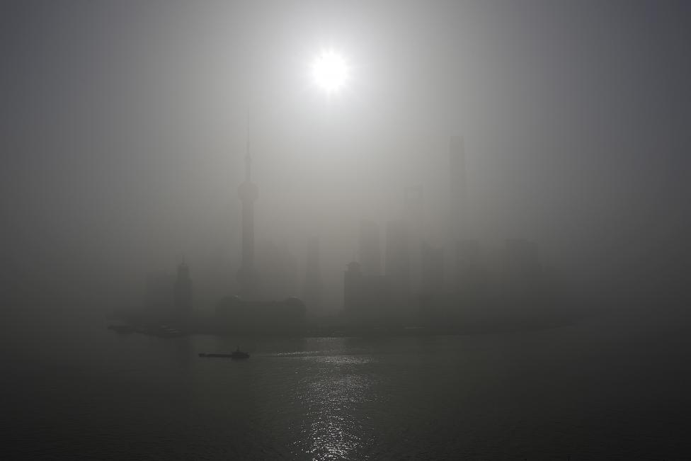 A general view of Shanghai's financial district of Pudong amid heavy smog is seen in Shanghai. REUTERS/Aly Song