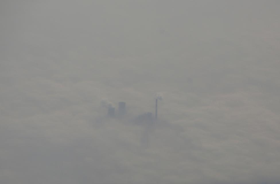 A thermal power plant is pictured amid heavy smog, from an aircraft over Hebei province. REUTERS/Jason Lee