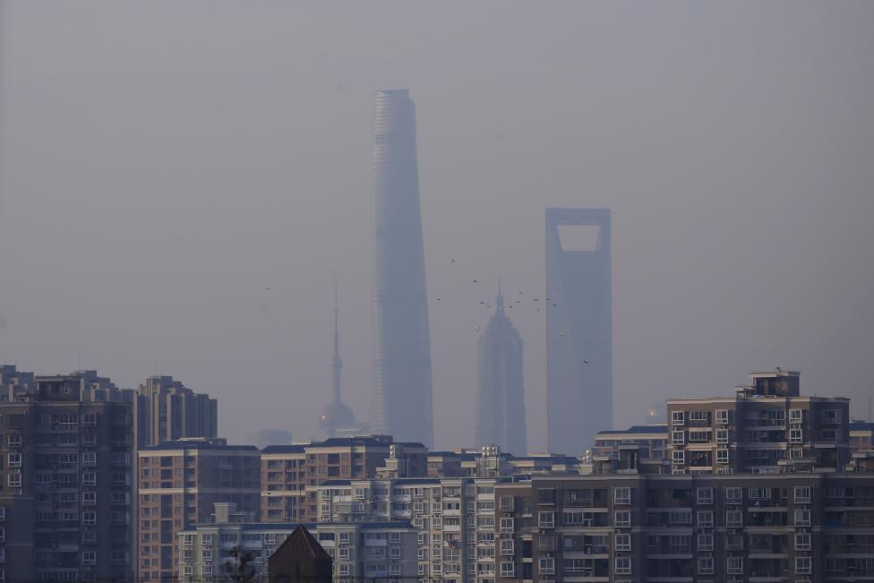 A view of Shanghai's skyscrapers, Oriental Pearl Tower (L), Shanghai Tower (2nd L), Jin Mao Tower (2nd R) and the Shanghai World Financial Center (R) are seen amid heavy smog in Shanghai.  REUTERS/Aly Song