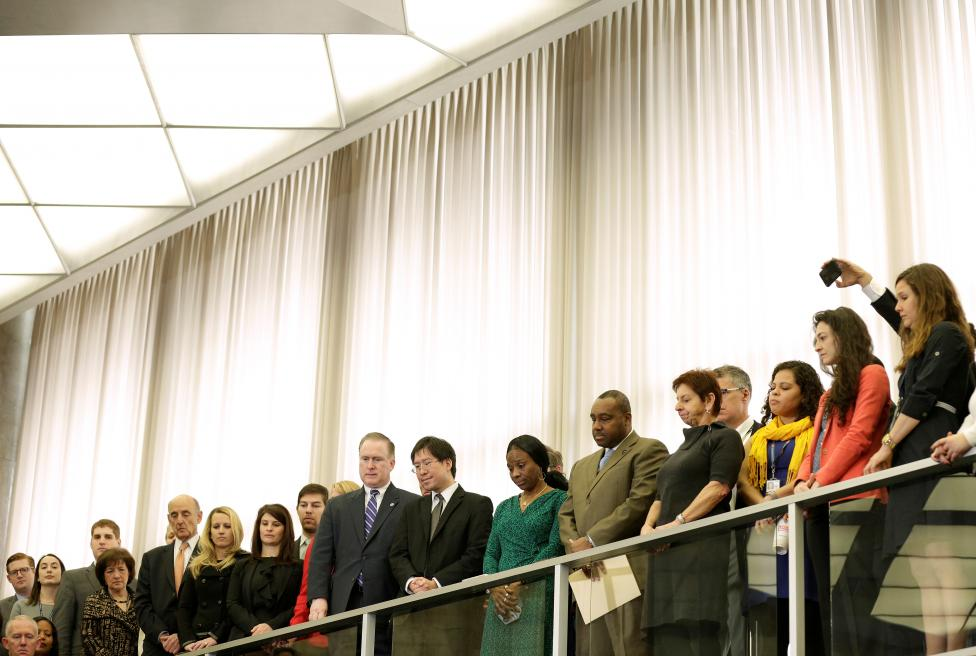 Department of State employees listen as U.S. Secretary of State Rex Tillerson delivers remarks upon arrival at the Department of State in Washington