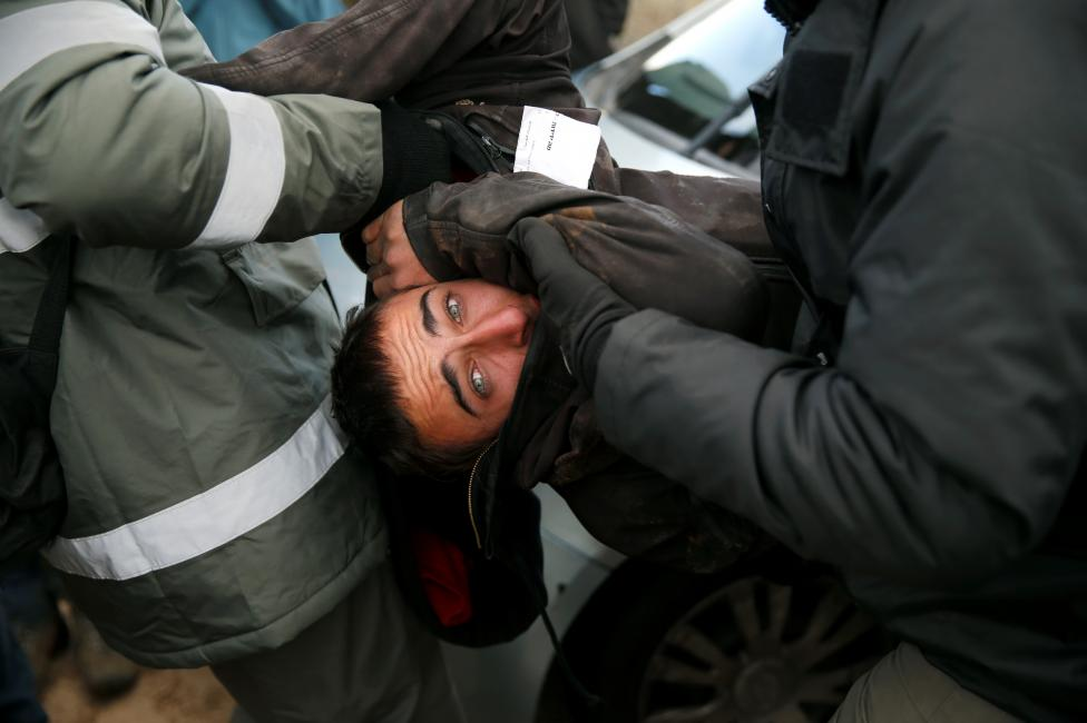 Israeli policemen remove a pro-settlement activist during an operation by Israeli forces to evict settlers from the illegal outpost of Amona in the occupied West Bank