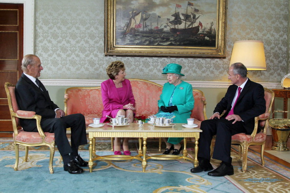 DUBLIN, IRELAND - MAY 17:  Prince Philip The Duke of Edinburgh,  President Mary Mc Aleese, Queen Elizabeth II and Dr Martin Mc Aleese talk over a cup of tea at Aras An Uachtarain on May 17, 2011 in Dublin,Ireland. The Queen's visit, accompanied by The Duke of Edinburgh, is the first by a monarch since 1911. An unprecedented security operation is taking place with much of the centre of Dublin turning into a car free zone. Republican dissident groups have made it clear they are intent on disrupting proceedings. (Photo by Irish Government - Pool/Getty Images)