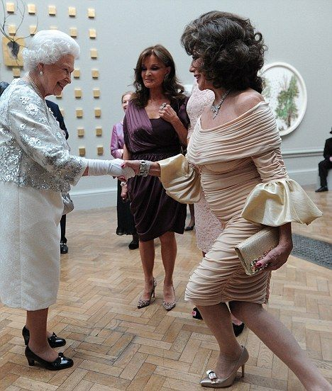 British actress Joan Collins (R) curtsies as she meets Queen Elizabeth II during her visit to the Royal Academy of Arts in central London, on May 23, 2012.   AFP PHOTO/ POOL/ CARL COURTCARL COURT/AFP/GettyImages