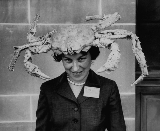 A woman wearing a crab hat at the League