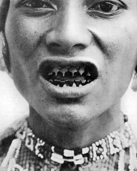A Bagobo, with filed teeth, circa 1910. The Bagobo are a people of southern coastal Mindanao in the Philippines. A print from 'Customs of the World, Volume II' Hutchinson and Co, Paternoster Row, London, pub 1913. (Photo by The Print Collector/Print Collector/Getty Images)