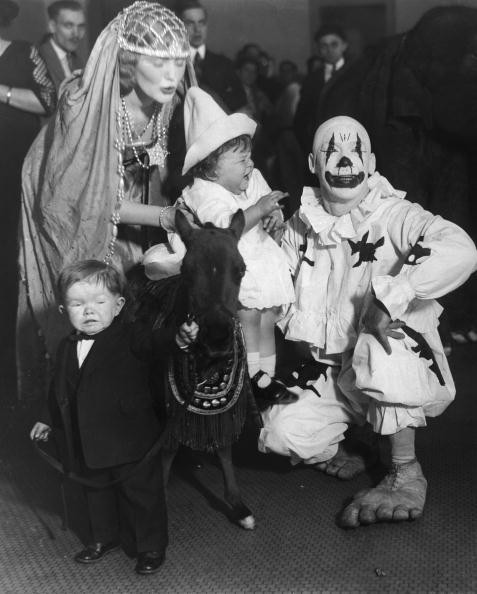Young Bernaby Flick appears traumatised by the experience of riding miniature horse 'Kneehi' during a visit by the circus to a children's hospital, circa 1930. Midget Major Mite (1913 - 1975), 'Cinderella' and clown Charlie Smith do nothing to allay his fears. (Photo by FPG/Hulton Archive/Getty Images)