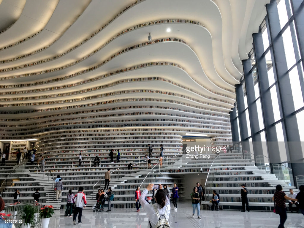"TIANJIN, CHINA - 2017/10/02: The Binhai new area library, opened in the National day, also called ""the eye of Binhai"", located in the cultural center of Binhai new area,  is a new cultural landmark and travel destination. (Photo by Zhang Peng/LightRocket via Getty Images)"
