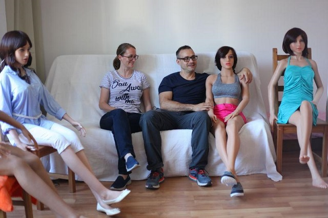Roboticist Sergi Santos and his wife Maritza Kissamitaki are seated with their sex robot creations in their home workshop, 12 July 2017, in the outskirts of Barcelona, Spain. Santos, who founded his company Synthea Amatus, aims to introduce sex robots with artificial intelligence to the consumer market. THOMSON REUTERS FOUNDATION/Lin Taylor