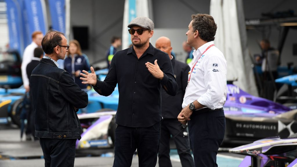 BROOKLYN, NY - JULY 14:  In this handout photo provided by Formula E, Leonardo DiCaprio tours the garages on the eve of this weekend's inaugural Formula E New York City ePrix on July 14, 2017 in the Brooklyn borough of New York City. This historic ePrix marks the first time that motor-sport racing has ever come to the five boroughs, something only possible because of Formula E's quiet, electric cars and commitment to sustainability. The New York City races are rounds 9 and 10 of the 12 race circuit, making this weekend's rounds some of the most exciting of the season, as drivers compete for the finishing top spots in the championship July 15 and 16 in New York.  (Photo by Sam Bagnall/Formula E via Getty Images)