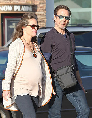 ©NATIONAL PHOTO GROUP  A very pregnant Susan Downey and Robert  Downey Jr. hold hands and stroll arm in arm in Malibu. Job: 011712J7 EXCLUSIVE Jan. 17th, 2012 Malibu, CA NPG.com   ALL OVER PRESS