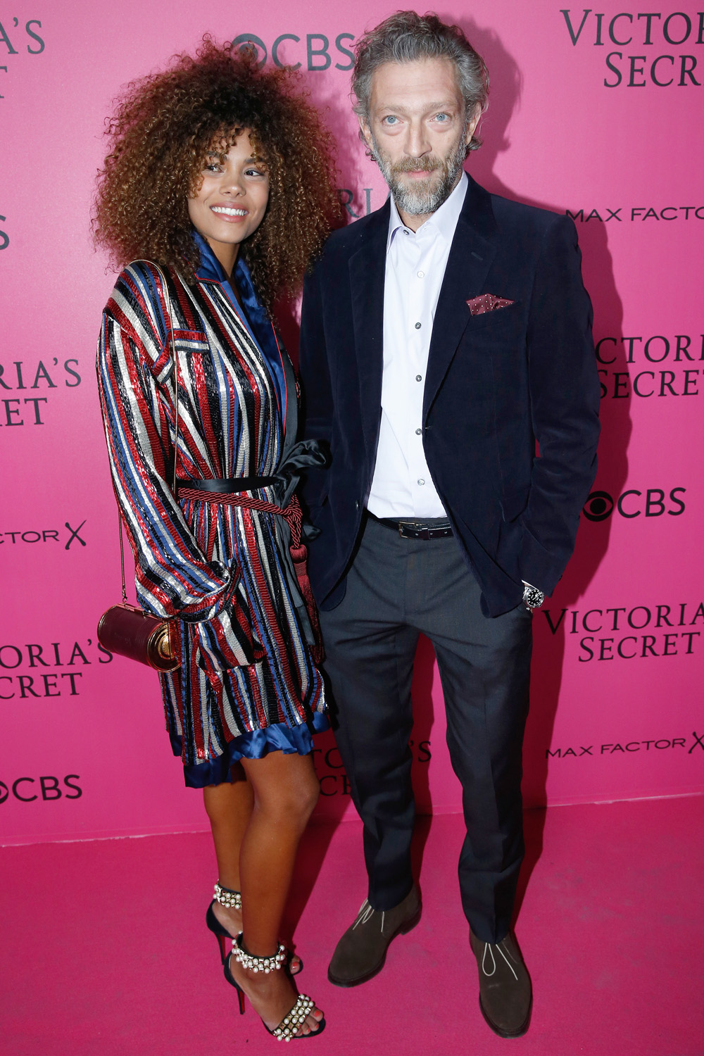 PARIS, FRANCE - NOVEMBER 30:  Actor Vincent Cassel and his companion Tina Kunakey attend the 2016 Victoria's Secret Fashion Show. Held at Grand Palais on November 30, 2016 in Paris, France.  (Photo by Bertrand Rindoff Petroff/Getty Images for Victoria's Secret)