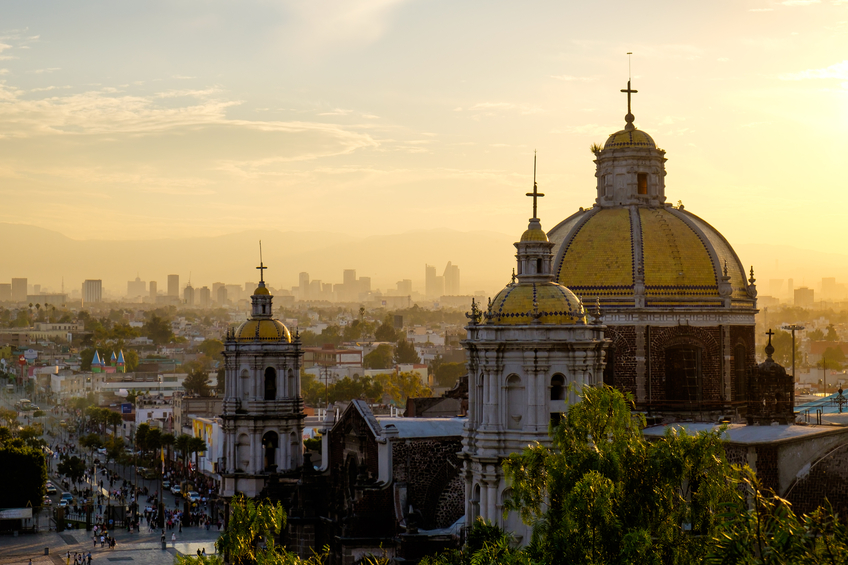Scenic view at Basilica of Guadalupe with Mexico city skyline at sunset, Mexico