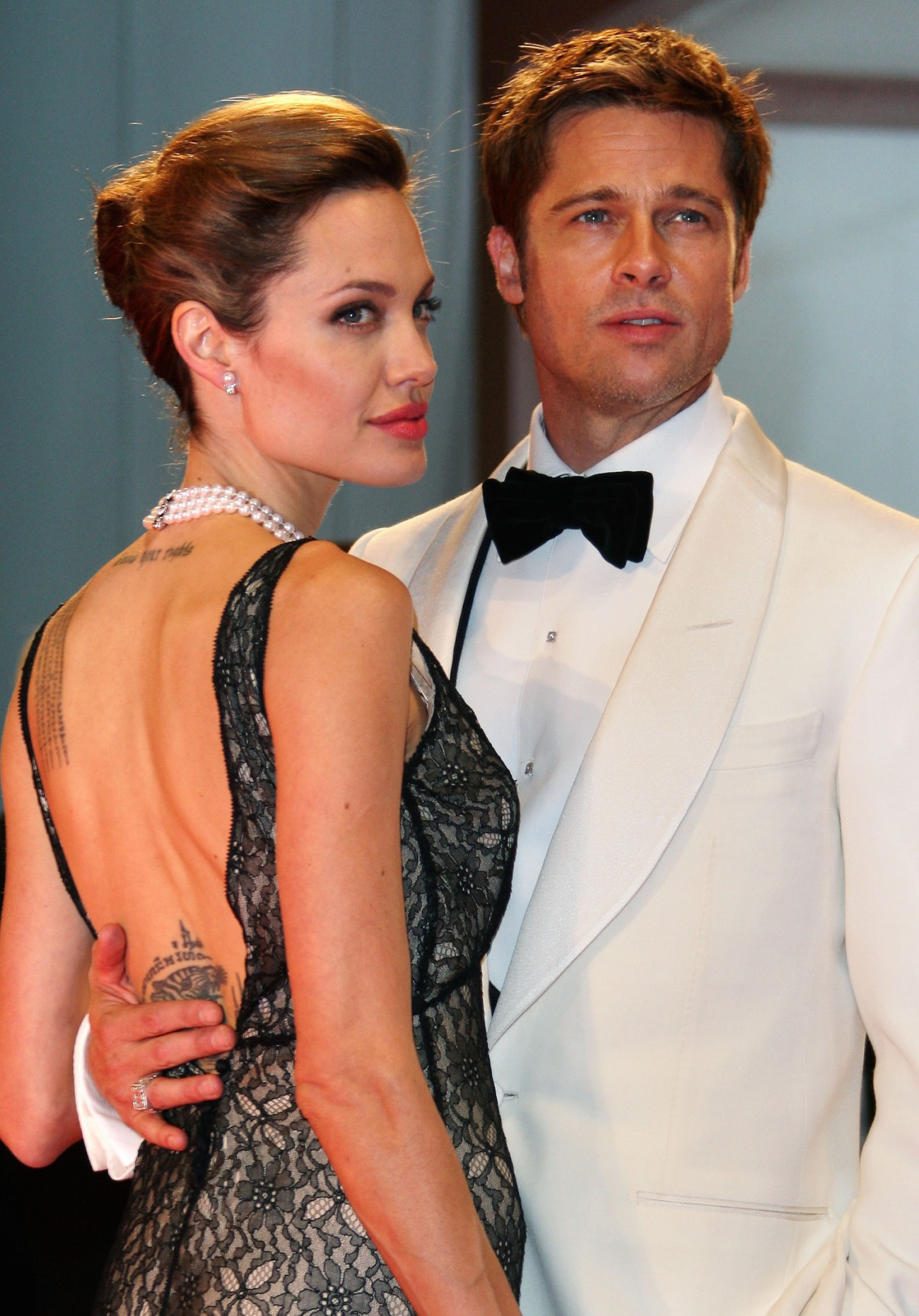 VENICE, ITALY - SEPTEMBER 02:  Angelina Jolie and Brad Pitt attend the The Assassination of Jesse James by the Coward Robert Ford premiere on the Day 5 of the 64th Annual Venice Film Festival on September 2, 2007 in Venice, Italy.  (Photo by MJ Kim/Getty Images)