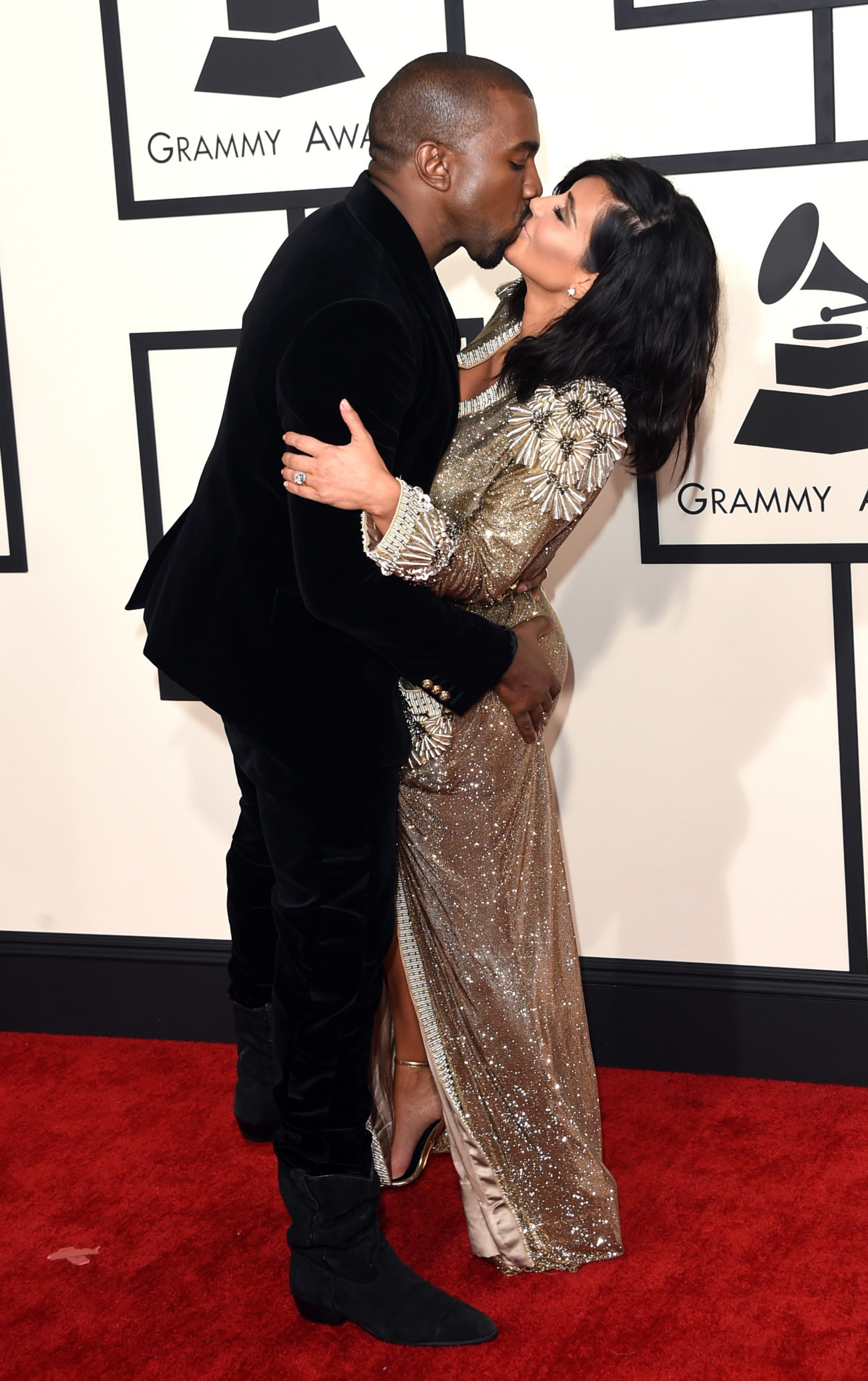 LOS ANGELES, CA - FEBRUARY 08:  Rapper Kanye West (L) and TV personality Kim Kardashian attend The 57th Annual GRAMMY Awards at the STAPLES Center on February 8, 2015 in Los Angeles, California.  (Photo by Jason Merritt/Getty Images)
