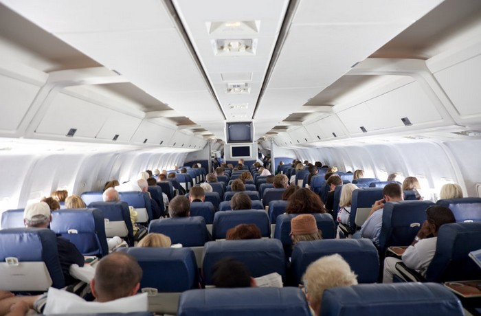 inside of an airplane with large group of people - long exposure - soft focus - camera canon 5D mark II - unsharped RAW - adobe colorspace