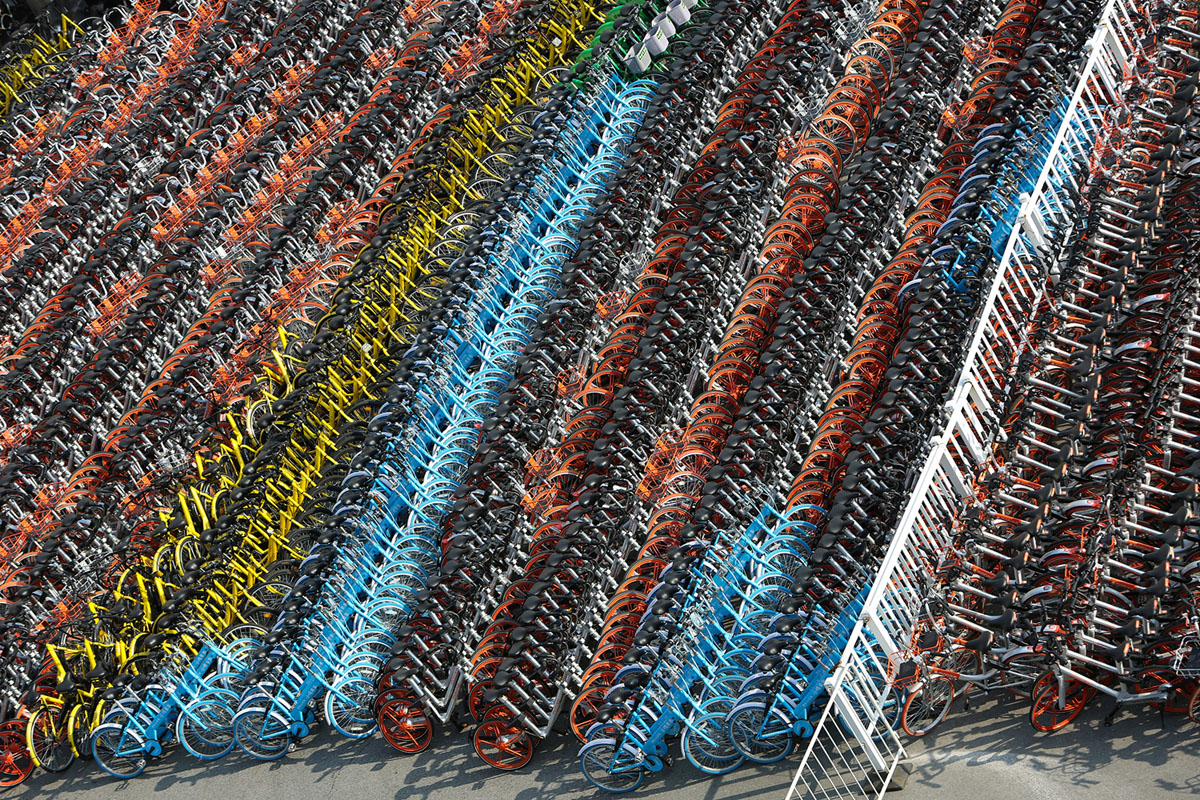 Confiscated sharing bicycles of different brands are seen at a parking lot of Huangpu District Vehicle Management Company in Shanghai, China, February 28, 2017. Picture taken February 28, 2017. REUTERS/Stringer ATTENTION EDITORS - THIS IMAGE WAS PROVIDED BY A THIRD PARTY. EDITORIAL USE ONLY. CHINA OUT. NO COMMERCIAL OR EDITORIAL SALES IN CHINA. - RC1B44C9A850