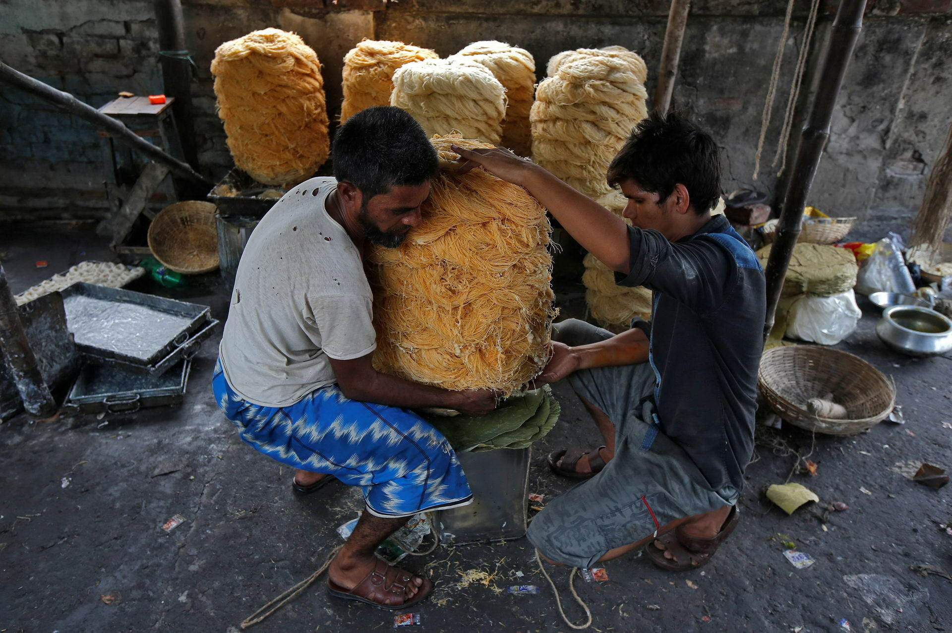 Workers pack vermicelli, a specialty eaten during the holy month of Ramadan, at a factory in Kolkata