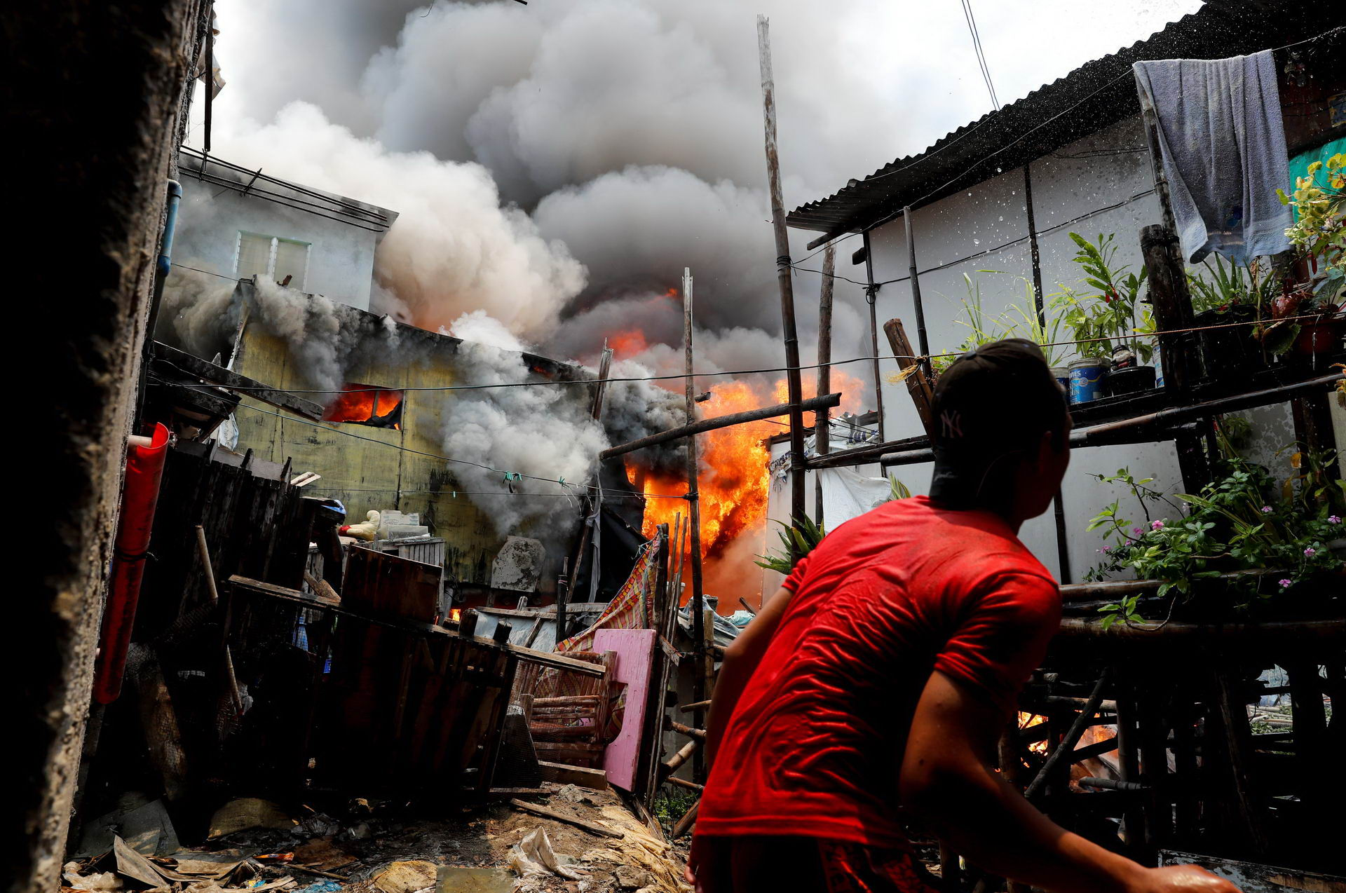 The Wider Image: Manila's slums an endless battle for firefighters