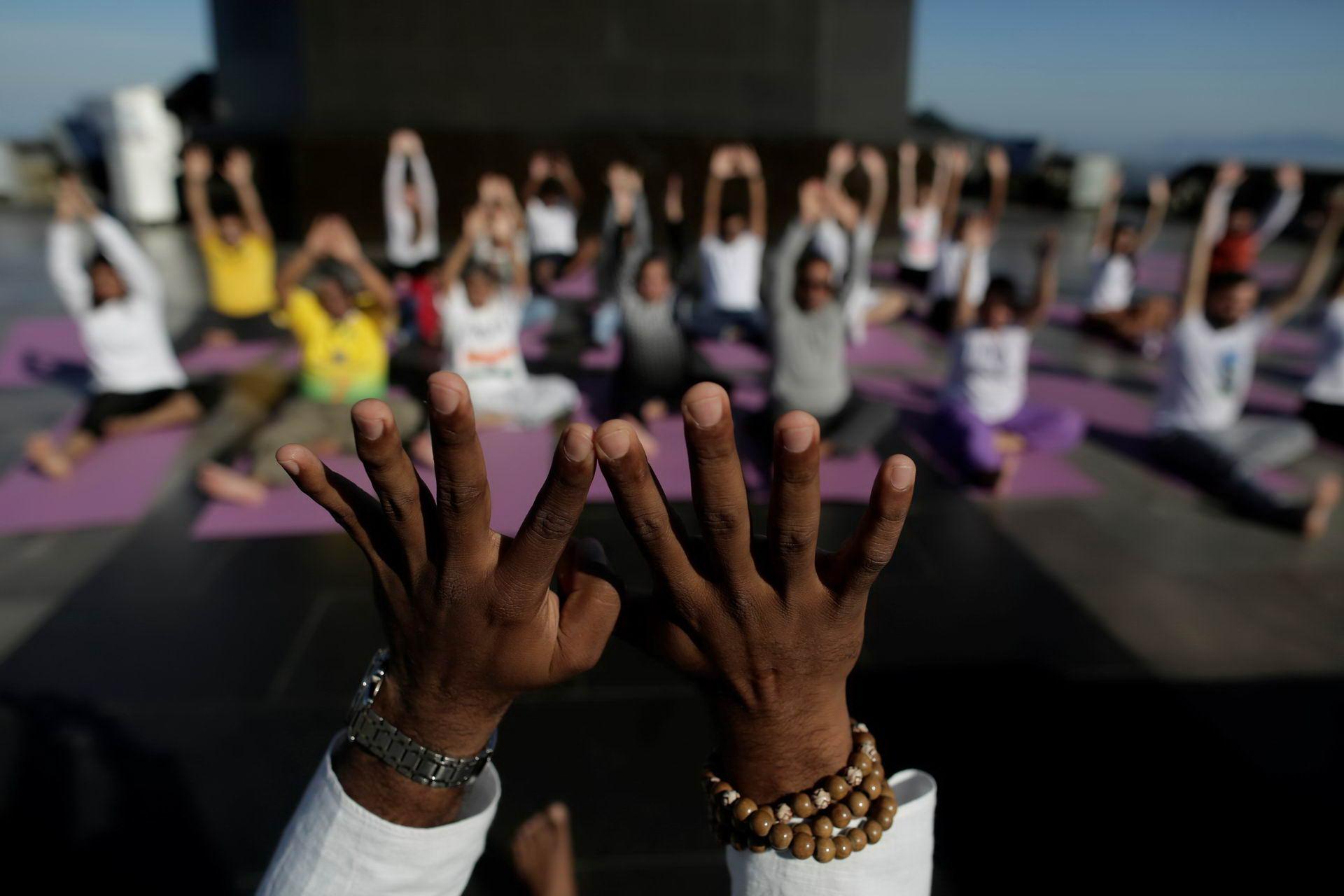 People perform yoga on International Yoga Day in Rio de Janeiro
