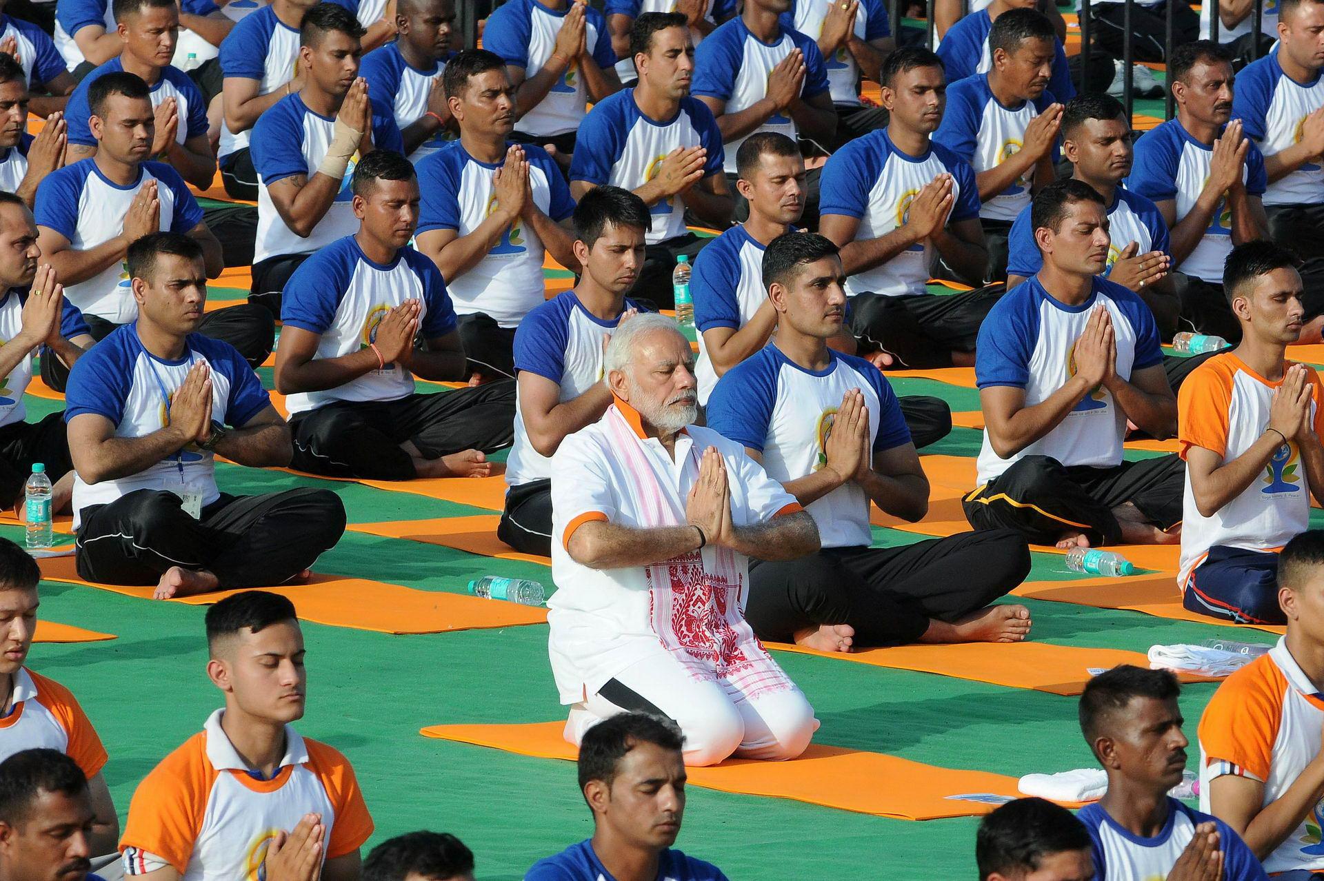 Indian Prime Minister Narendra Modi performs yoga on International Yoga Day in Dehradun