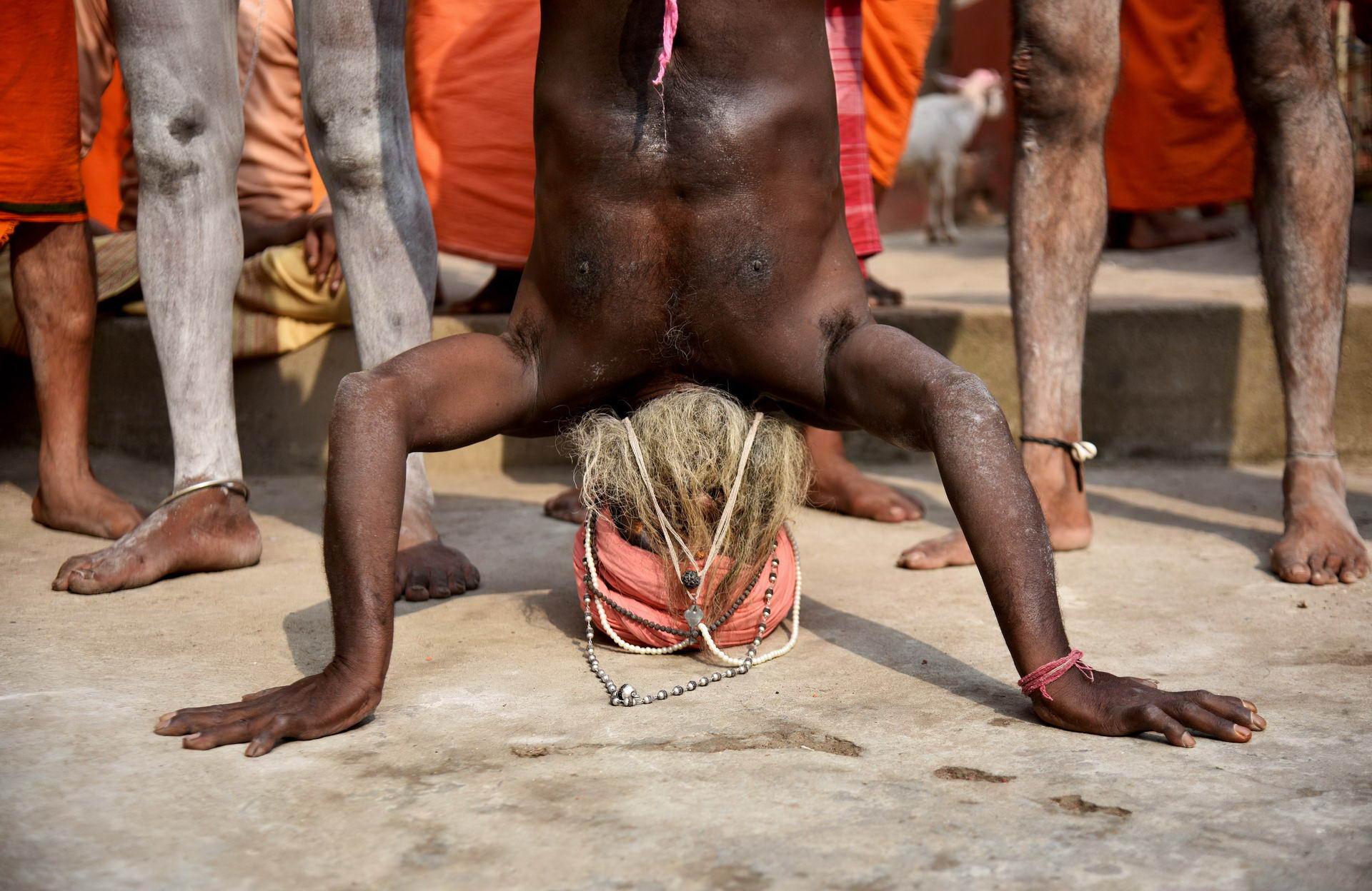 A Sadhu or a Hindu holy man performs yoga on International Yoga Day at Kamakhya temple in Guwahati