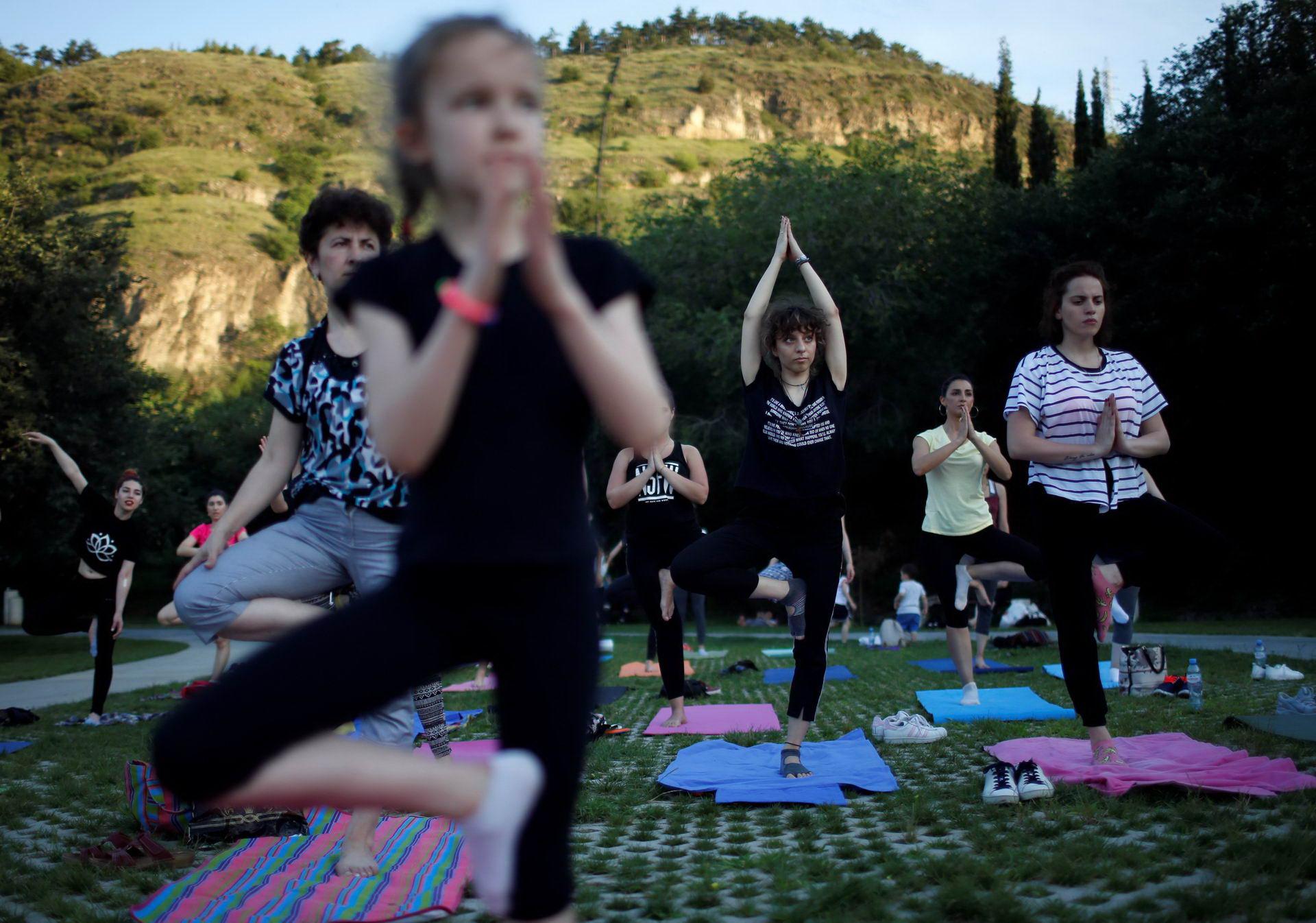 People perform yoga on International Yoga Day in Tbilisi