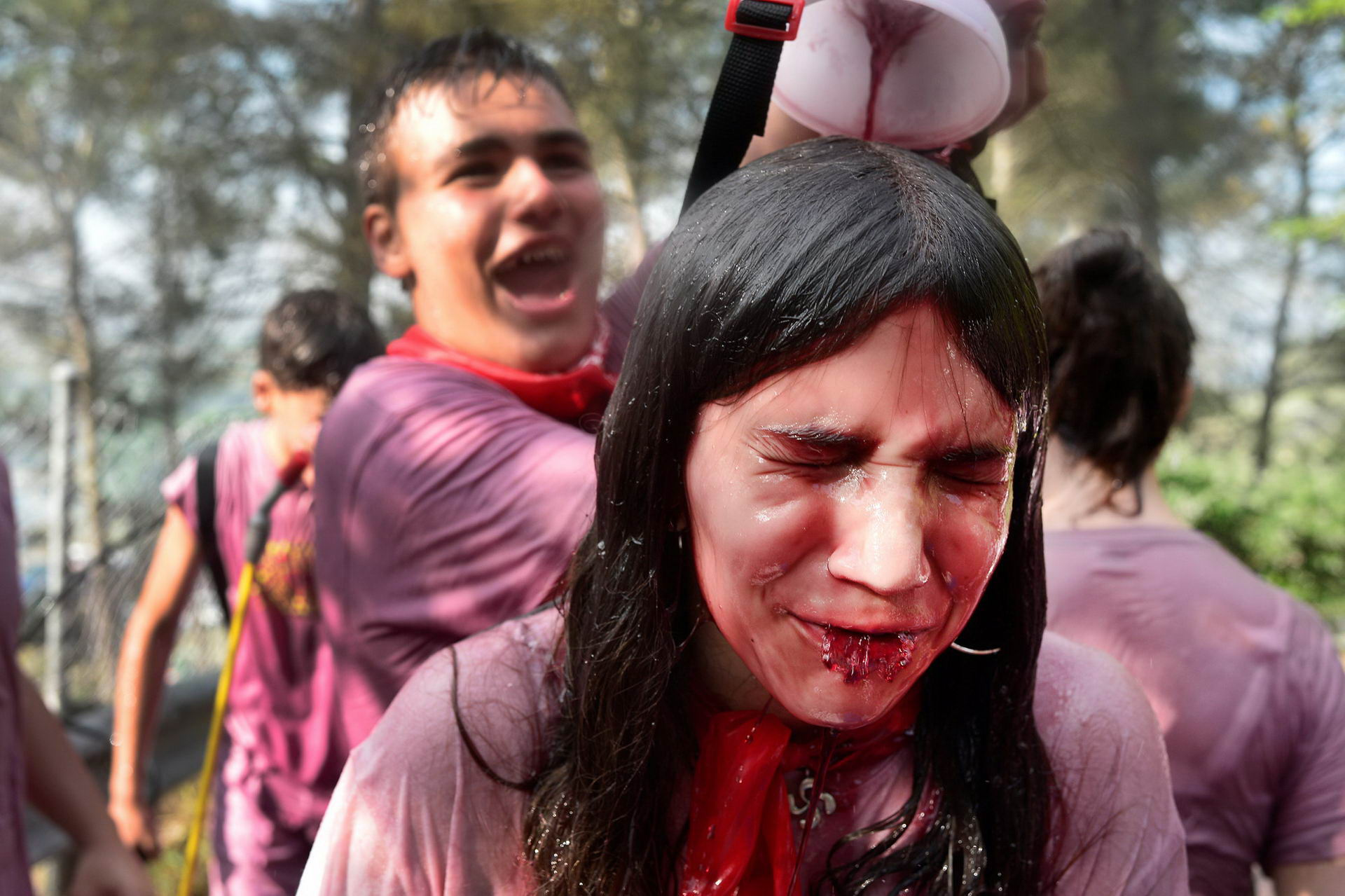 A reveller has wine poured over her during the Batalla de Vino (Wine Battle) in Haro