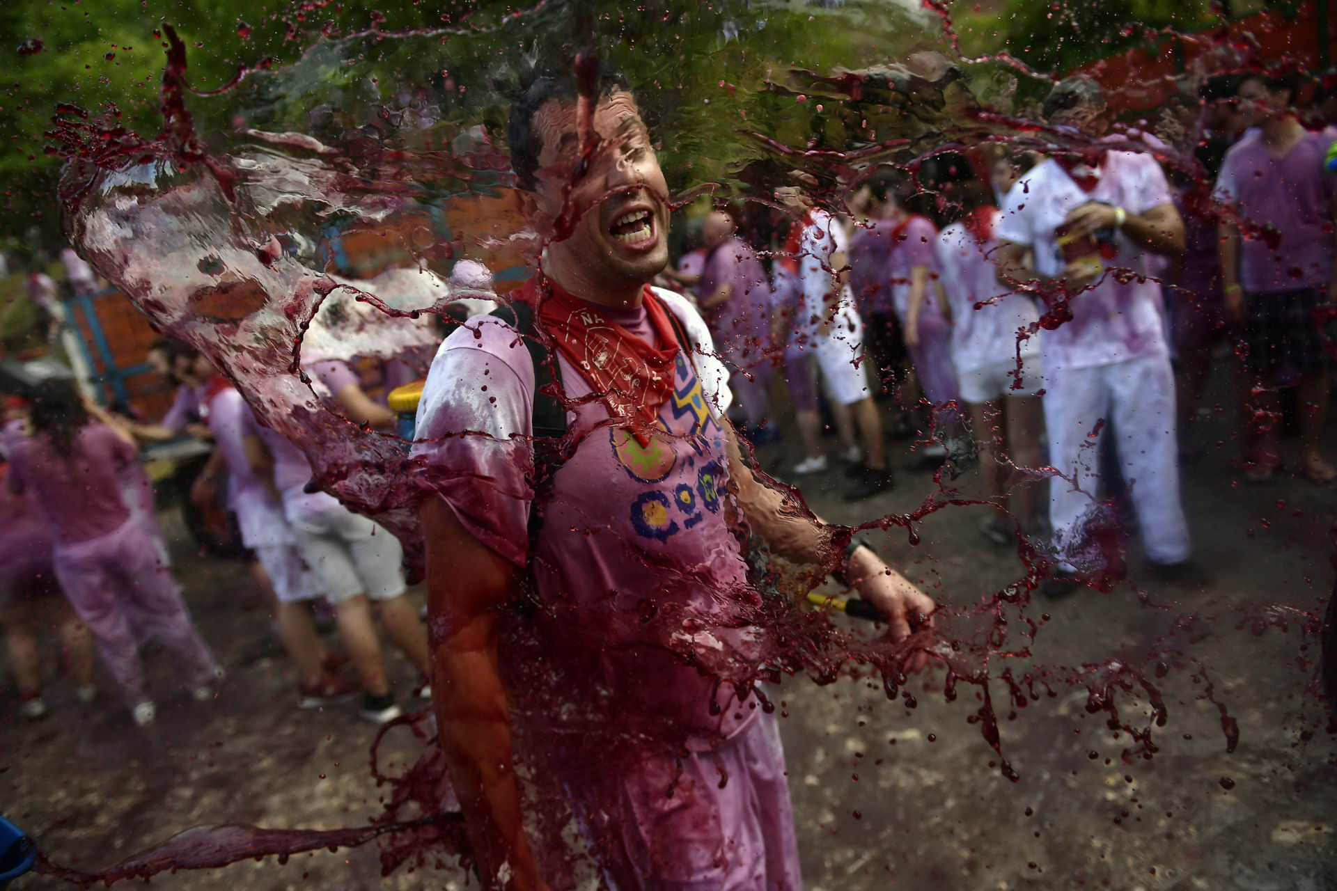 revellers battle it out with wine in Spain