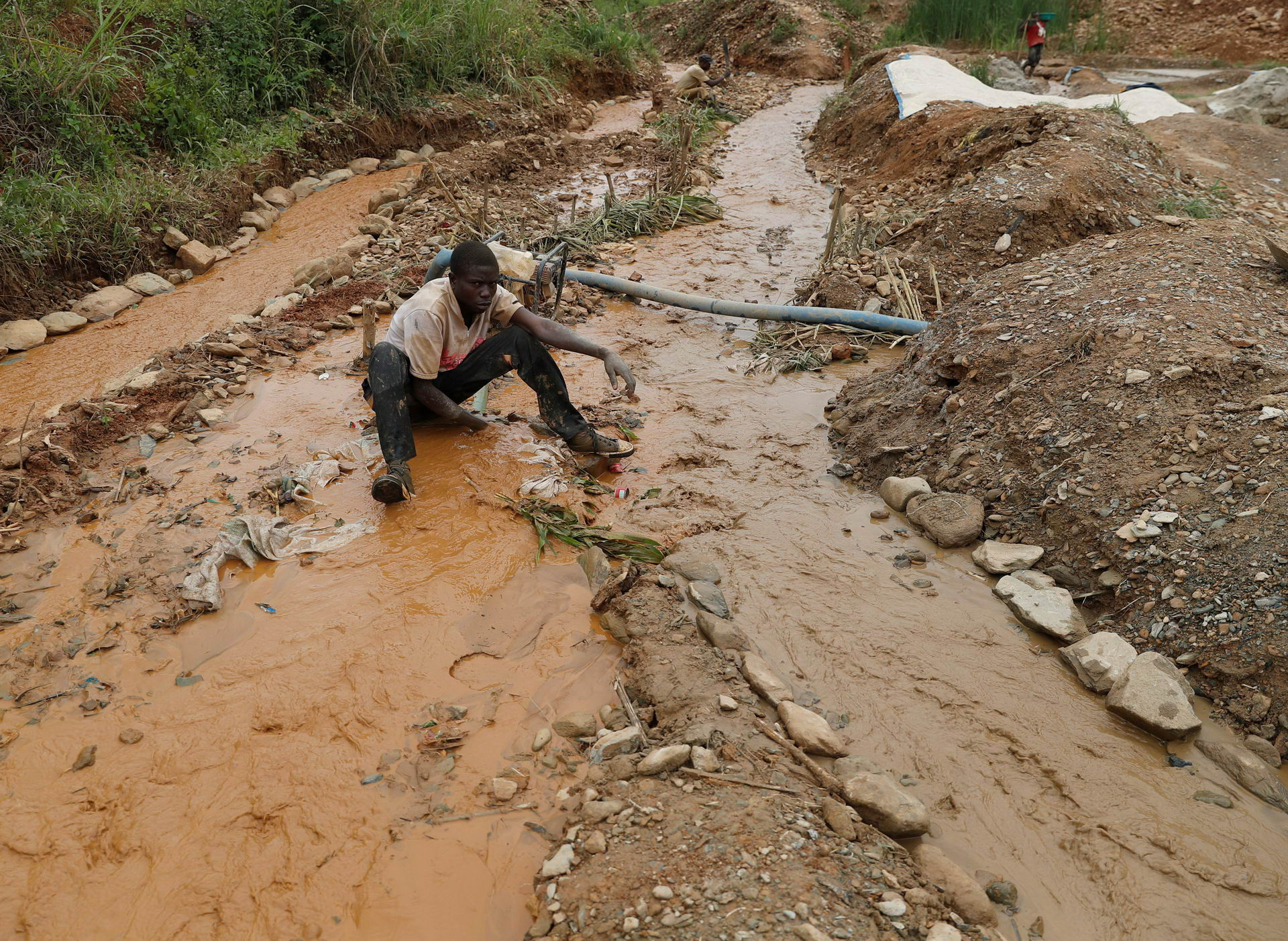 A young man works at Makala gold mine camp near the town of Mongbwalu in Ituri province