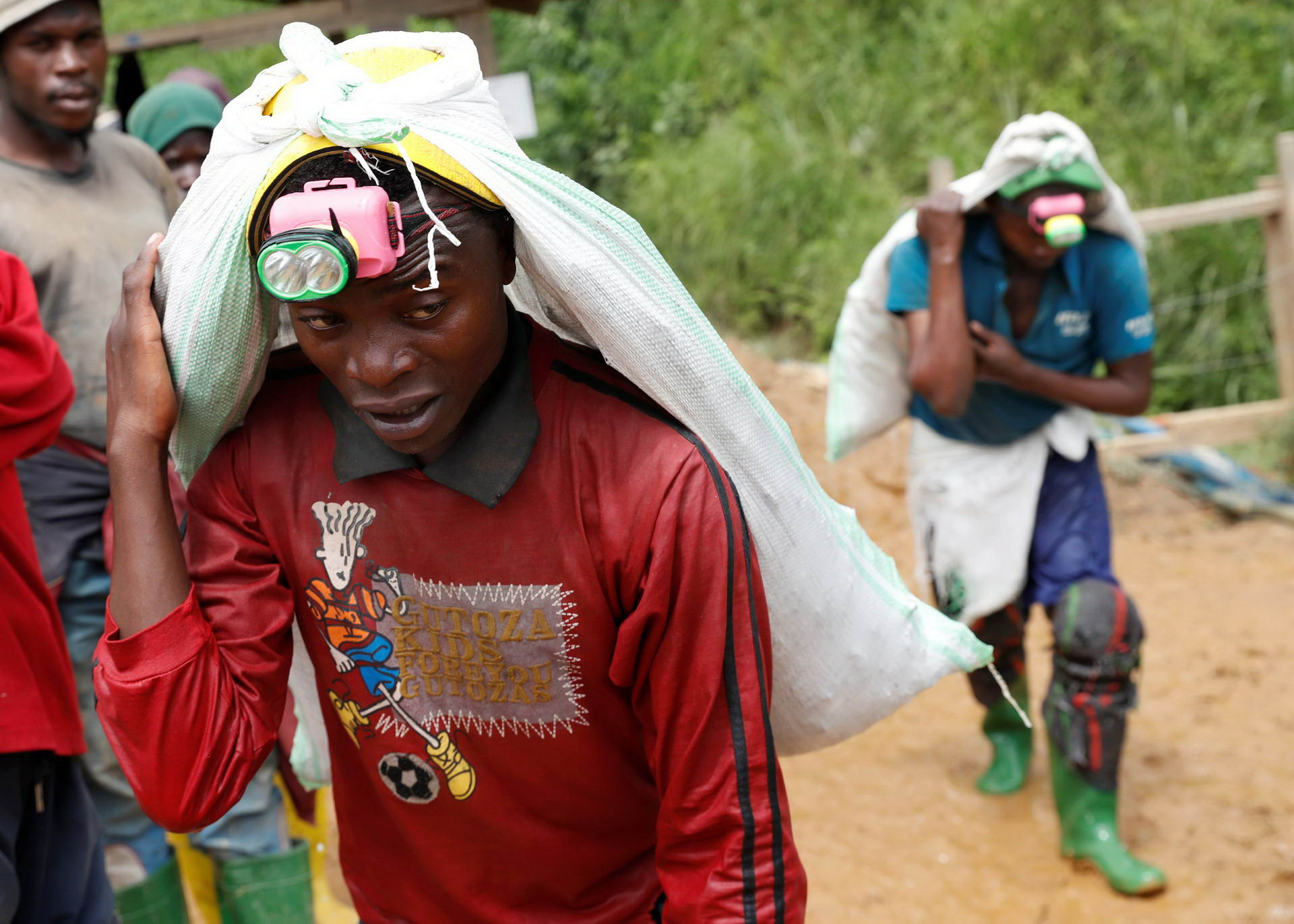 Men work at Makala gold mine camp near the town of Mongbwalu in Ituri province