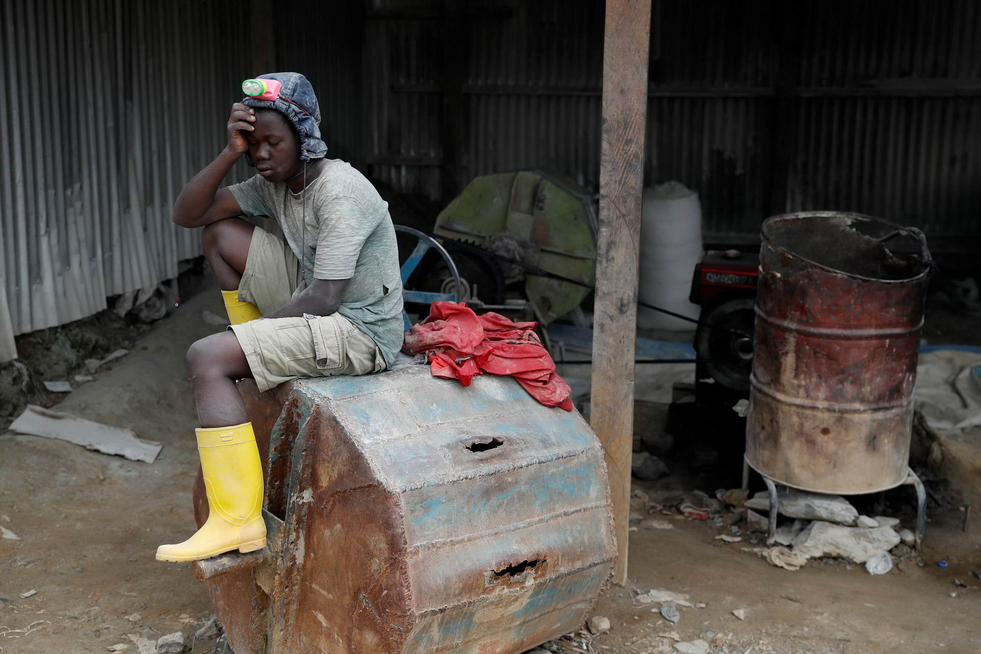 A young miner sleeps at Makala gold mine camp near the town of Mongbwalu in Ituri province