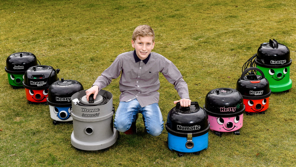 LAD COLLECTS HOOVERS