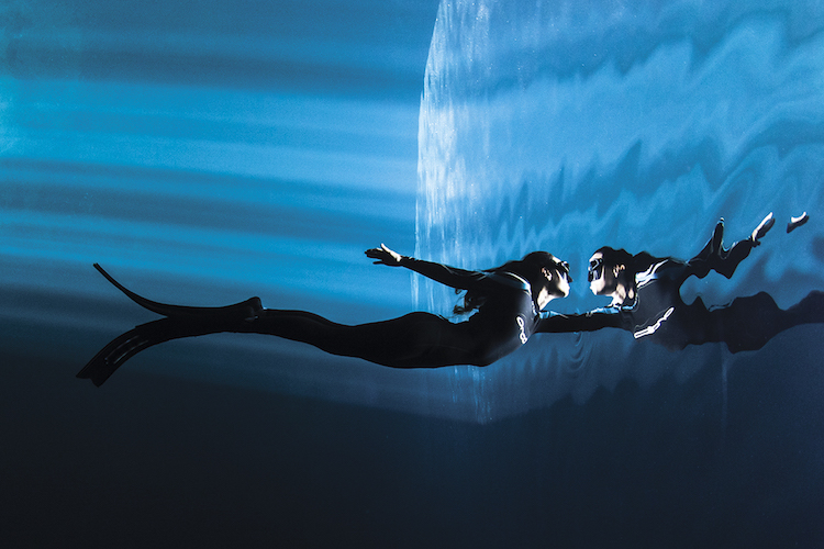 Mexico, Quintana Roo. A freediver champion encounters her mirror while ascending to the surfacte of cenote The Pit.