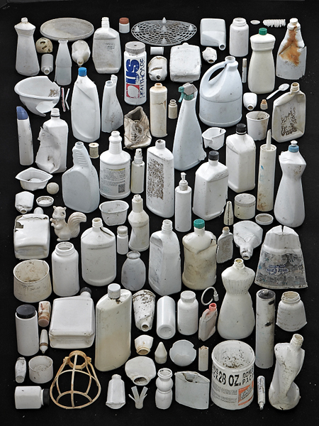white plastic bottles on a black background