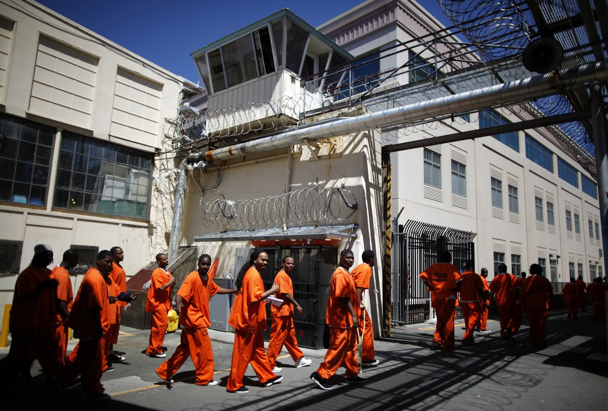 Inmates walk in at San Quentin state prison