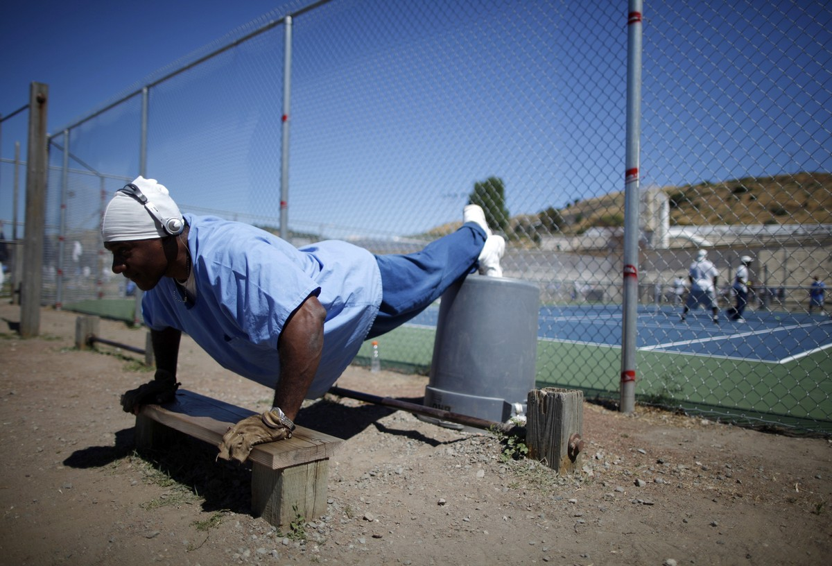 An inmate does push-ups in the exercise yard at San Quentin state prison